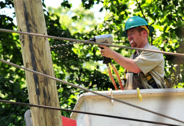 A linesman works on electrical wire in the aftermath of last week's storms, July 2, 2012 in Takoma Park, Maryland. UPI/Kevin Dietsch