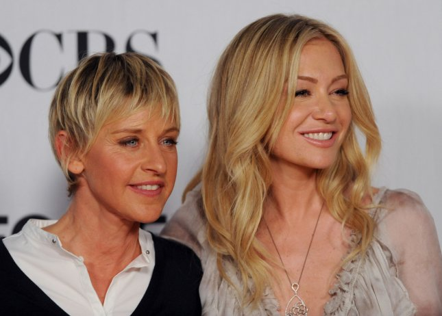 Comedian Ellen Degeneres (L) and actress Portia de Rossi appear backstage after Degeneres won the award for Favorite Talk Show Host at the 35th annual People's Choice Awards in Los Angeles on January 7, 2009. (UPI Photo/Jim Ruymen)