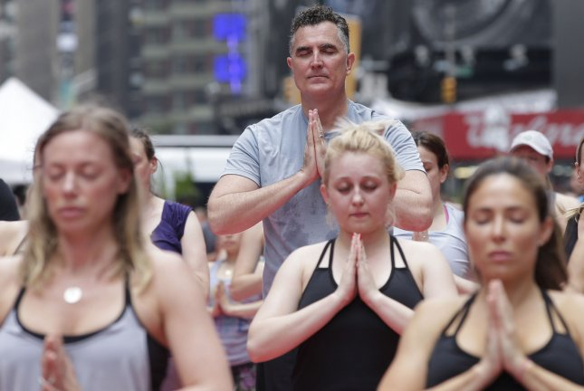 The move by Russian city officials comes soon after the worldwide celebration of the first International Day of Yoga, established by the United Nations. Thousands of participants in the June 21 event gathered in Times Square in New York City. More than 17,000 thousand yogis were expected to participate in six classes (about 3,000 people per class) during the 13th annual Solstice in Times Square. File Photo by John Angelillo/UPI