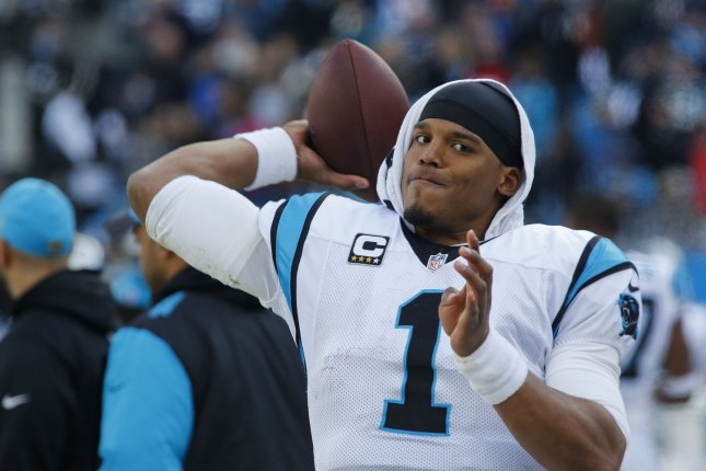7588fa724bd Carolina Panthers quarterback Cam Newton warms up on the sidelines as the Panthers  play the Seattle Seahawks in a NFC divisional playoff football game at ...