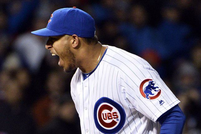 Chicago Cubs relief pitcher Hector Rondon reacts after striking out the side during the ninth inning of the Cubs home opener against the Cincinnati Reds at Wrigley Field in Chicago on April 11, 2016. The Cubs defeated the Reds 5-3. Photo by Brian Kersey/UPI