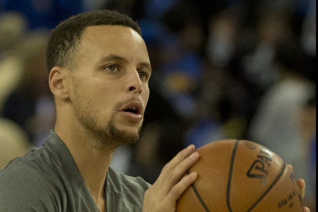 Golden State Warriors' Stephen Curry warms up to play the San Antonio Spurs at Oracle Arena in Oakland, California on April 7, 2016. Photo by Terry Schmitt/UPI
