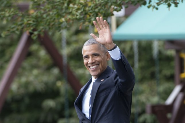 President Barack Obama waves as he walks across the South Lawn of the White House in Washington, D.C., to Marine One for his trip to Pennsylvania and Ohio on Thursday. Obama, speaking at an Ohio Democratic Party fundraiser Thursday night, said messages through conservatives that include Fox News and Rush Limbaugh have built divisiveness and anger in the country. Photo by Molly Riley/UPI