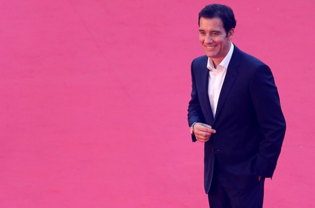 Clive Owen arrives on the red carpet before at the 9th annual Rome International Film Festival on October 18, 2014. The British actor is to star in the Broadway revival of M. Butterfly in the fall. File Photo by David Silpa/UPI