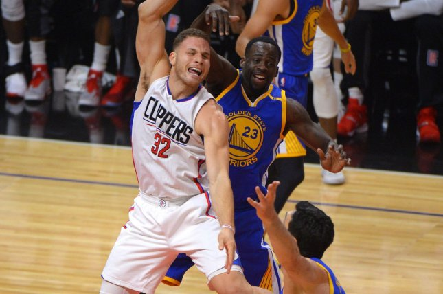 Clippers forward Blake Griffin (32) and Warriors Draymond Green fight for the ball at Staples Center in Los Angeles, December 7, 2016. Photo by Jon SooHoo/UPI