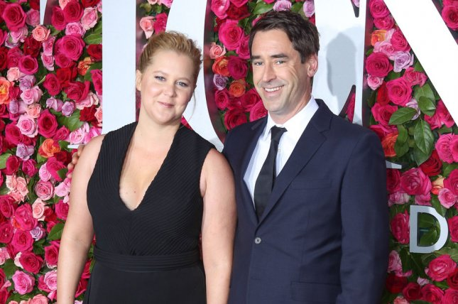 Amy Schumer (L), pictured with Chris Fischer, dedicated a sweet and funny post to Fischer on their six-month anniversary. File Photo by Serena Xu-Ning/UPI
