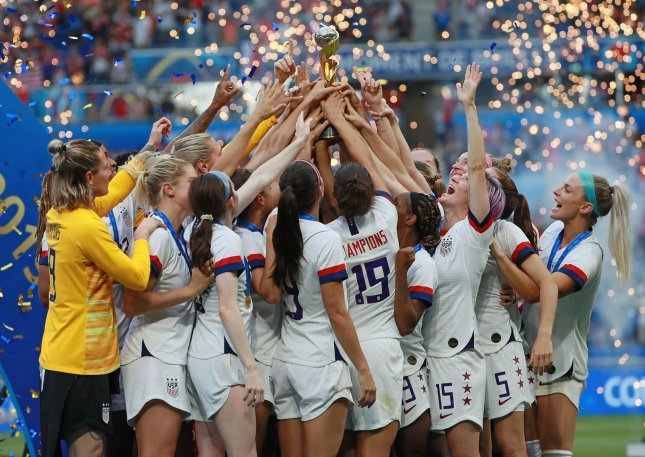 Team USA celebrates with the championship trophy after winning the 2019 FIFA Women's World Cup final against the Netherlands on Sunday at the Stade de Lyon in Lyon, France. Photo by David Silpa/UPI