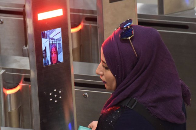 A Palestinian woman scans a bio-metric card to crossthe new Qalandiya checkpoint between Jerusalem and Ramallah, West Bank, on Thursday, Photo by Debbie Hill/UPI
