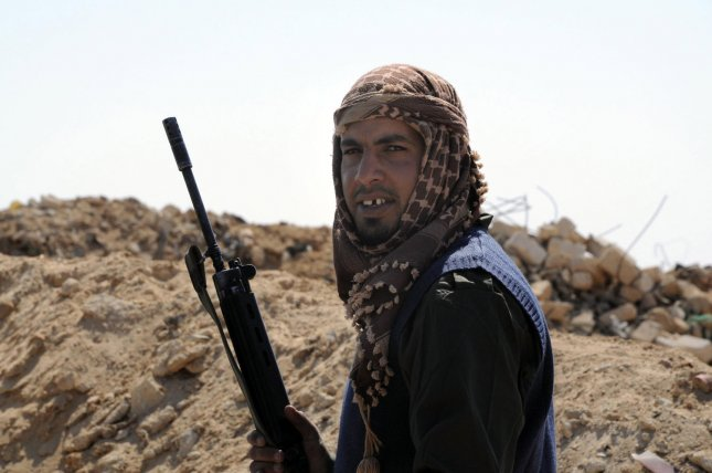 A Libyan Rebel a monitor the area near the Ajdabiya at a check point prior heading towards the front line outside the Libyan eastern city Ajdabiya on May 12, 2011, where fighting between rebels and forces loyal to leader Moamer Kadhafi is ongoing. Rebels controlled the airport in Misurata, spokesmen for the Libyan rebels said. UPI\Tarek Alhuony