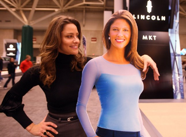 Jill Wagner, The Mercury Girl stands next to a photo cutout of herself, while signing autographs at the 2009 St. Louis Auto Show at America's Center in St. Louis on January 31, 2009. Wagner is the National spokesperson for the Mercury automobile line. (UPI Photo/Bill Greenblatt)