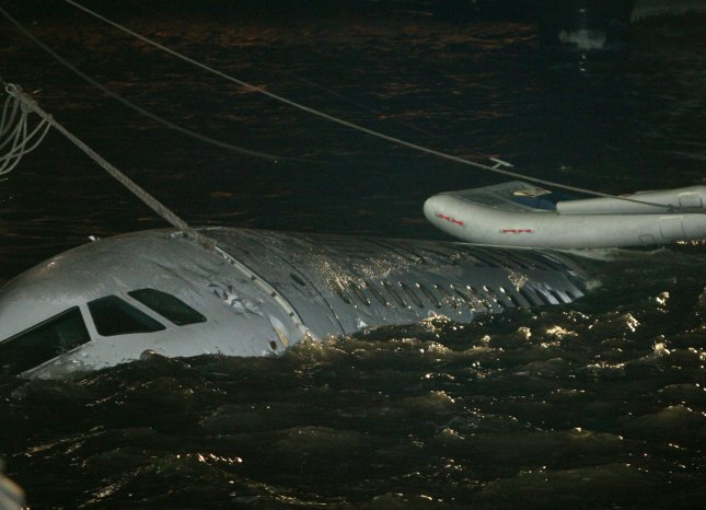 The half-submerged US Air jet is docked in Battery Park City after it drifted downriver following an emergency water landing in the Hudson River on January 15, 2009 in New York City. (UPI Photo/Monika Graff)