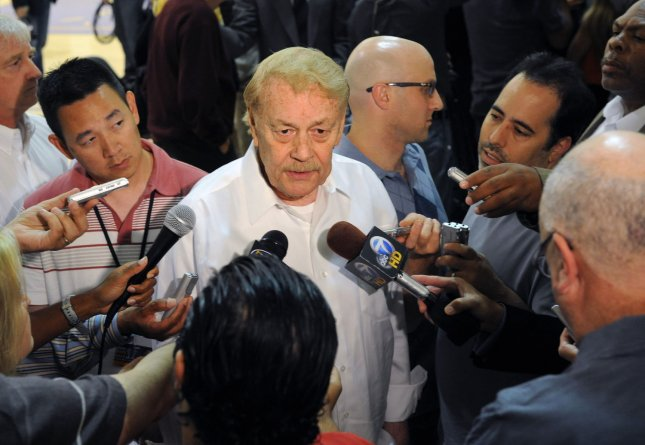 Los Angeles Lakers owner Jerry Buss (C), shown during a 2011 news conference, died Monday at the age of 80. UPI/Jim Ruymen