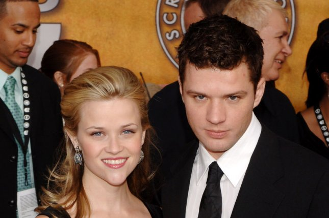 Ryan Phillippe (R) with then-wife Reese Witherspoon in 2006. File photo by Jim Ruymen/UPI