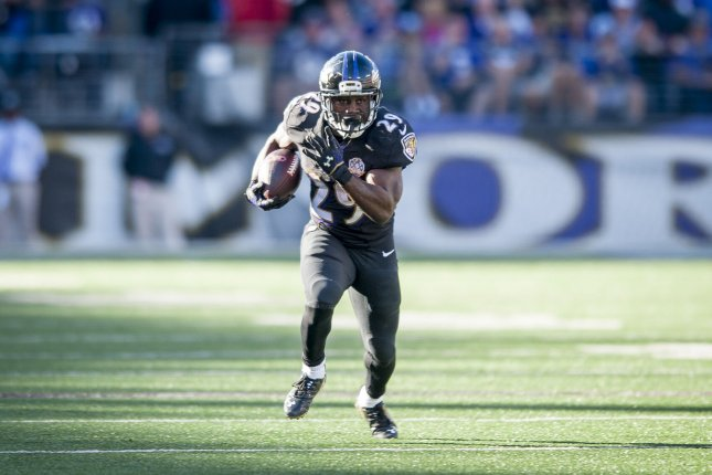 Baltimore Ravens' running back, Justin Forsett, runs the ball during fourth quarter action against the Cleveland Browns at M&M Bank Stadium on October 11, 2015 in Baltimore, Maryland. Cleveland won the game 33-30. Photo by Pete Marovich/UPI