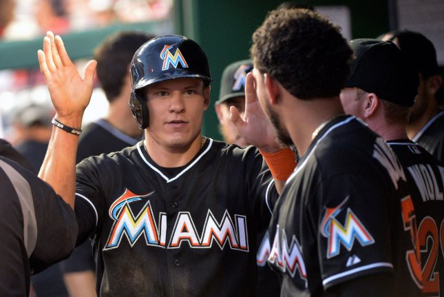 Derek Dietrich and the Miami Marlins got past the Cincinnati Reds on Thursday. Photo by Kevin Dietsch/UPI