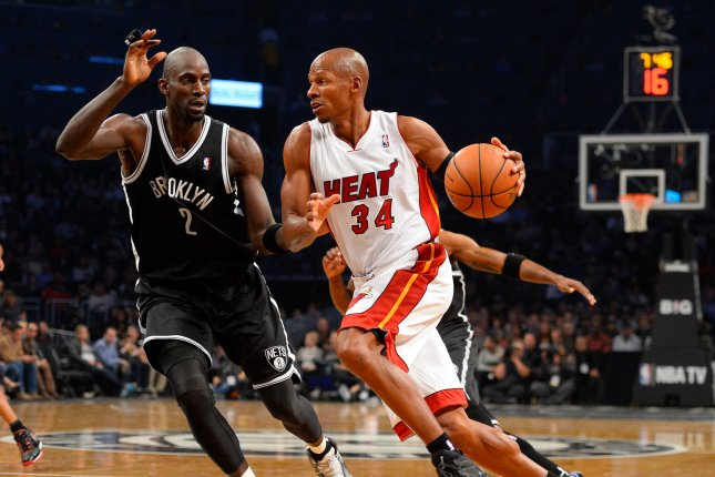 Former Miami Heat shooting guard Ray Allen (34) drives in against Brooklyn Nets power forward Kevin Garnett (2) during the second quarter at Barclays Center in New York City on November 1, 2013. File photo by Rich Kane/UPI