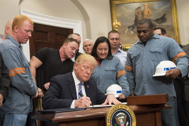 President Donald Trump signs a proclamation applying tariffs to steel and aluminum imports, as he is joined by steel and aluminum makers in the Roosevelt Room at the White House in Washington, D.C. on Thursday. President Trump is calling for a 25 percent tariff on steel and 10 percent on aluminum, carve-outs may be added for allies such as Canada and Mexico. Photo by Kevin Dietsch/UPI