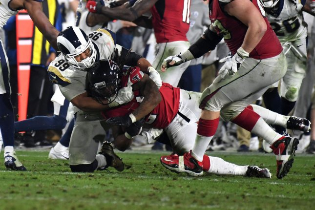 Los Angeles Rams defensive tackle Aaron Donald (L) tackles Atlanta Falcons running back Devonta Freeman (R) for a loss during their NFC Wild Card Playoff Game at the Los Angeles Coliseum in Los Angeles on January 6. Photo by Jon SooHoo/UPI