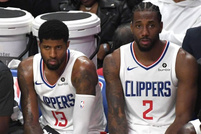 Paul George (13) and Kawhi Leonard (2) will lead the Los Angeles Clippers in a matchup against the Los Angeles Lakers on Thursday in Orlando, Fla. File Photo by Jon SooHoo/UPI