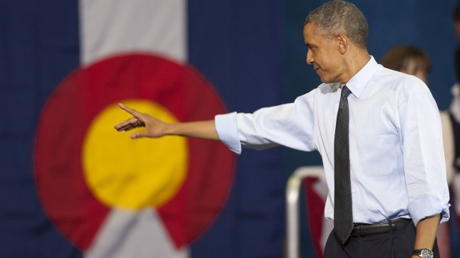 President Barack Obama waves in front of a Colorado state flag in Denver on August 8, 2012. UPI/Gary C. Caskey