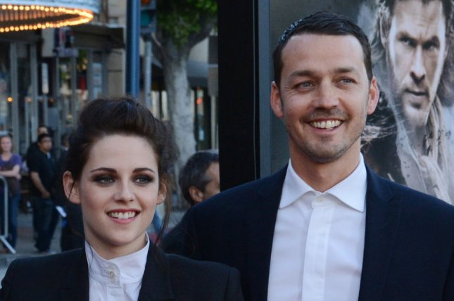 Rupert Sanders and Kristen Stewart issued public apologies for hurting their respective partners after photos were published July 24, 2012 showing the director and his Snow White and the Huntsman leading lady embracing and kissing. Sanders and Stewart are pictured attending a screening of the film on May 29, 2012. (UPI/Jim Ruymen)