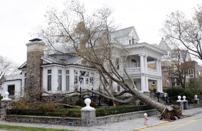 A fallen tree rests on a house in Cliffside, N.J., Oct. 31, 2012, in the aftermath of what was often called Superstorm Sandy. UPI/John Angelillo