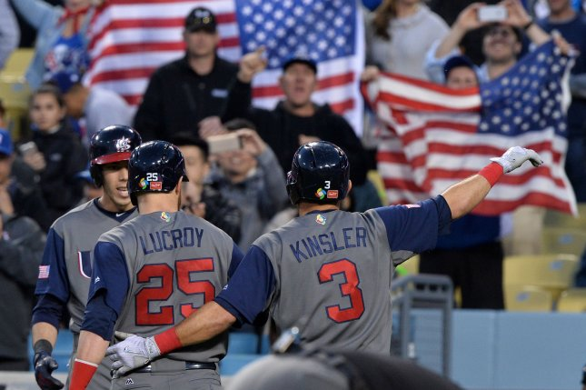 United States second baseman Ian Kinsler # 3 is welcomed back to the dugout after hitting a two run homer in the World Baseball Classic final at Dodger Stadium in Los Angeles on March 22, 2017. Team USA defeated Team Puerto Rico 8-0 in the championship game to win the 2017 World Baseball Classic. Photo by Jim Ruymen/UPI