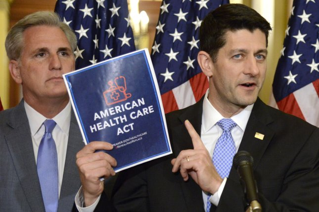 House Speaker Paul Ryan (R) holds a copy of the new healthcare bill introduced by Republicans on March 17 as Majority Leader Kevin McCarthy of California looks on. A new amendment may increase the odds of the GOP plan passing a House vote. File Photo by Mike Theiler/UPI