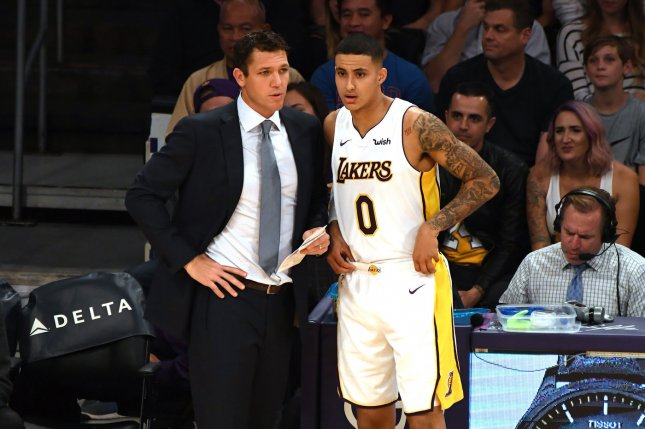 Lakers head coach Luke Walton (L) talks to forward Kyle Kuzma during second quarter action against Grizzlies (9) at Staples Center in Los Angeles, November 5, 2017. File photo by Jon SooHoo/UPI