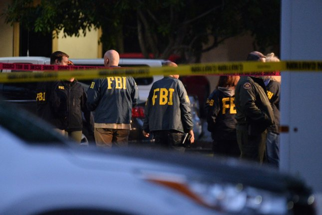 FBI personal gather in a secured area near the Borderline Bar and Grill where a Marine veteran opened fire in an explosion of violence reported to have claimed at least 12 lives on Thursday. Photo by Jim Ruymen/UPI