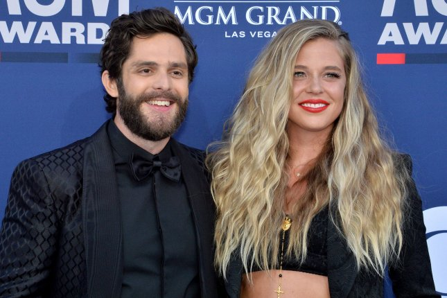 Thomas Rhett (L) and his wife Lauren Akins are expecting their third daughter together. File Photo by Jim Ruymen/UPI