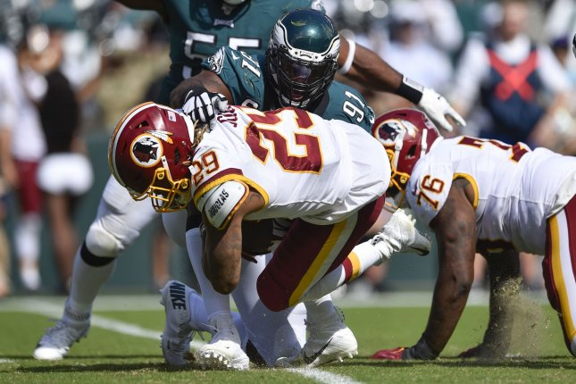 Washington Redskins running back Derrius Guice (29) is tackled by Philadelphia Eagles defensive tackle Fletcher Cox (91) during the second half Sunday at Lincoln Financial Field in Philadelphia. The Eagles won 32-27. Photo by Derik Hamilton/UPI