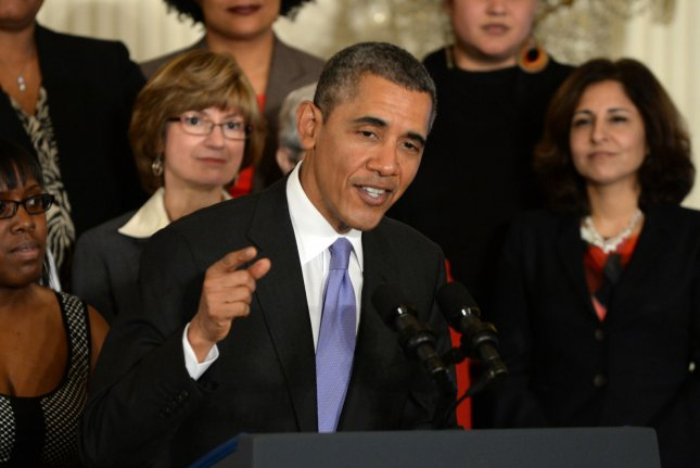 President Barack Obama makes remarks before signing two executive orders regarding equal pay for women at an event in the East Room of the White House in Washington, DC on April 8, 2014. Obama chastised Republicans at a fundraiser Wednesday evening for blocking the bill, calling this Congress the least productive in modern history. UPI/Pat Benic