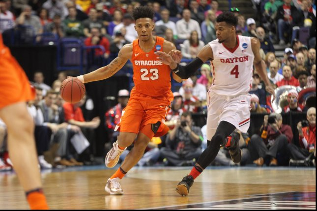 Syracuse's Malachi Richardson (23) gets past Dayton's Charles Cooke as he brings the basketball up court in the second half of the NCAA Division 1 Men's Basketball Championship at the Scottrade Center in St. Louis on March 18, 2016. Syracuse defeated Dayton 70-51. Photo by Bill Greenblatt/UPI