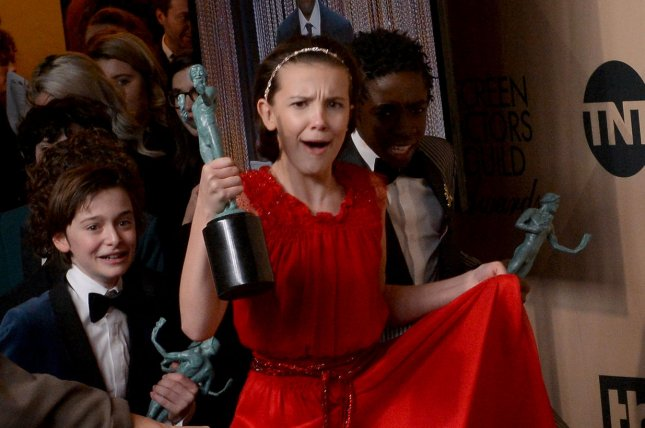 Millie Bobby Brown appears backstage with her award for Outstanding Performance by an Ensemble in a Drama Series for Stranger Things during the the 23rd annual SAG Awards in Los Angeles on January 29, 2017. Photo by Jim Ruymen/UPI