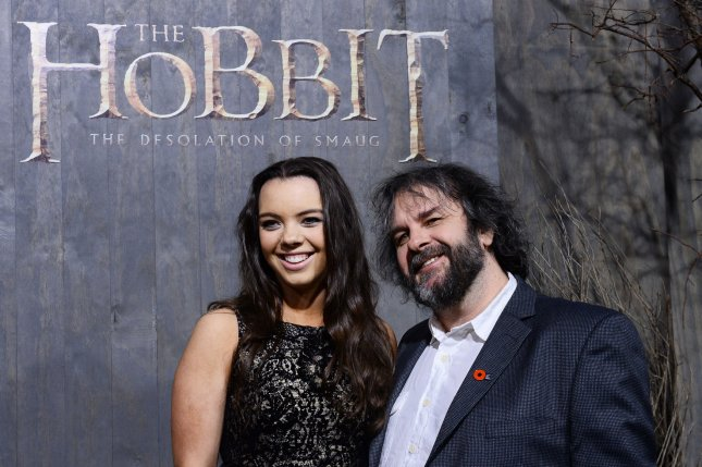 Writer, producer and director Peter Jackson attends with his daughter, Katie, the premiere of The Hobbit: The Desolation of Smaug at TCL Chinese Theatre in the Hollywood section of Los Angeles on December 2, 2013. On September 21, 1937, J.R.R. Tolkien published The Hobbit. File Photo by Jim Ruymen/UPI