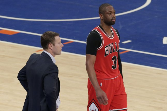 7914637a407 Chicago Bulls head coach Fred Hoiberg and Dwyane Wade stand on the court in  the second half against the New York Knicks at Madison Square Garden in New  York ...