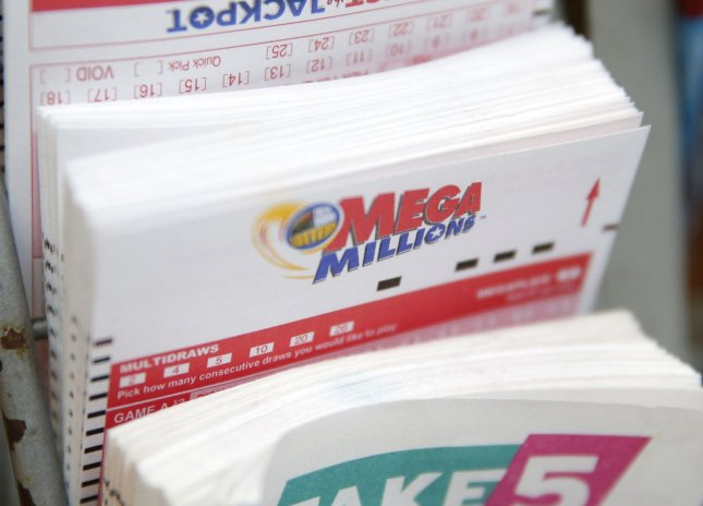 Mega Millions entry tickets are on display at a newspaper stand on July 23, 2018 in New York City. The Mega Millions prize for Tuesday's drawing is now $493 million. Photo by John Angelillo/UPI