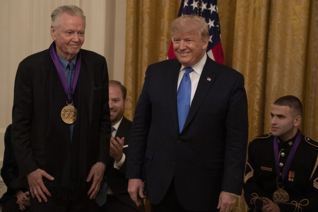 Actor Jon Voight receives the National Medal of Arts from President Donald Trump at the White House in Washington, D.C., on Thursday. Photo by Tasos Katopodis/UPI