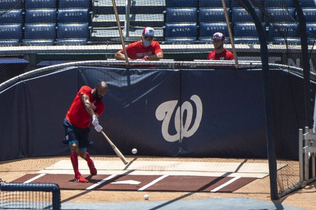 Washington Nationals first baseman Eric Thames participated in a workout Thursday at Nationals Park in Washington, D.C., after players from last year's team received World Series rings. Photo by Kevin Dietsch/UPI