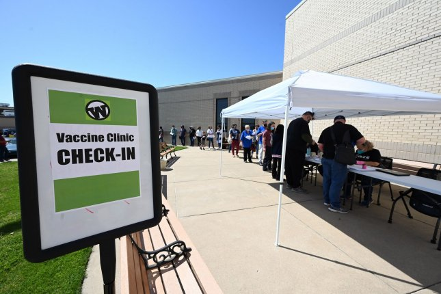 Teachers and school employees in Wylie, Texas, receive a COVID-19 vaccine on March 26. The pandemic was behind a record surge in Medicaid enrollment during 2020, officials said Monday. File photo by Ian Halperin/UPI