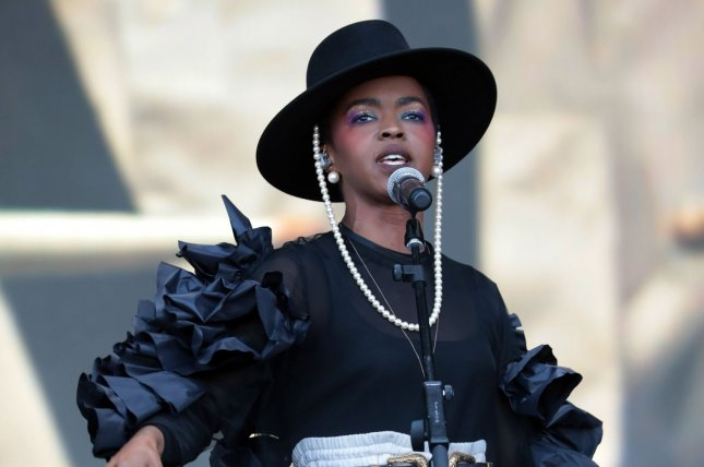 Lauryn Hill (pictured), Wyclef Jean and Pras Michel of the Fugees will kick off their first tour in 25 years Wednesday in New York. FilePhoto by Hugo Philpott/UPI