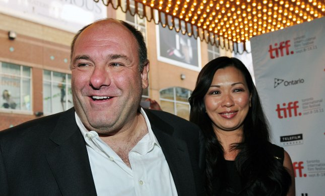 Actor James Gandolfini and his wife Deborah Lin arrive for the world premiere of 'Violet & Daisy' at the Elgin Theatre during the Toronto International Film Festival in Toronto, Sept. 15, 2011. UPI/Christine Chew