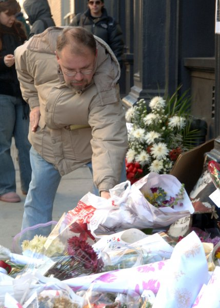 Fans continue to leave floral tributes on January 25, 2008 at the make shift memorial outside the apartment building on Broome Street where 28 year old actor Heath Ledger died in New York on January 22, 2008. (UPI Photo/Ezio Petersen)