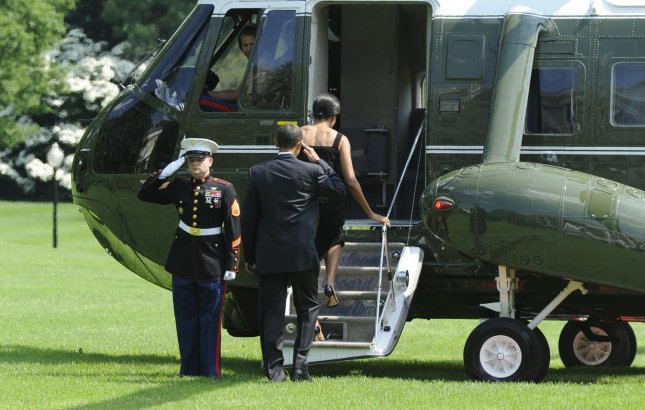 U.S. President Barack Obama and First Lady Michelle Obama walk out of the White House toward Marine One in Washington on May 30, 2009. The Obamas are traveling to New York City for a personal visit. (UPI Photo/Alexis C. Glenn)