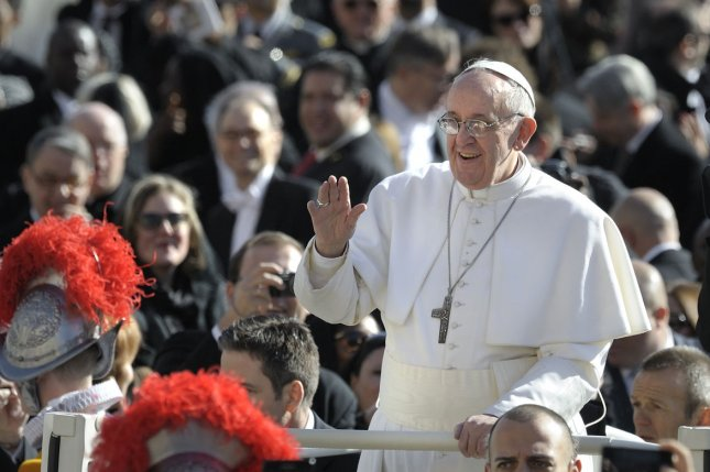 Pope Francis waves from the papamobile as he arrives for his inauguration mass at the Vatican at St Peter's Square on March 19, 2013. (UPI/Stefano Spaziani)