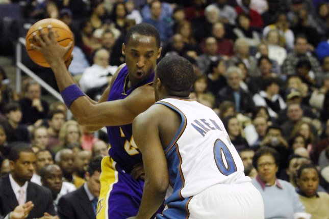 Los Angeles Lakers guard Kobe Bryant (24) works in the second half against former Washington Wizards guard Gilbert Arenas (0) on February 3, 2007 at Verizon Center in Washington, D.C. (UPI Photo/ Mark Goldman)