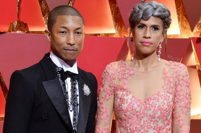 Pharrell Williams (L) with producer Mimi Valdez. Williams and Valdez are working with Black-ish creator Kenya Barris on a new stage musical. File Photo by Jim Ruymen/UPI