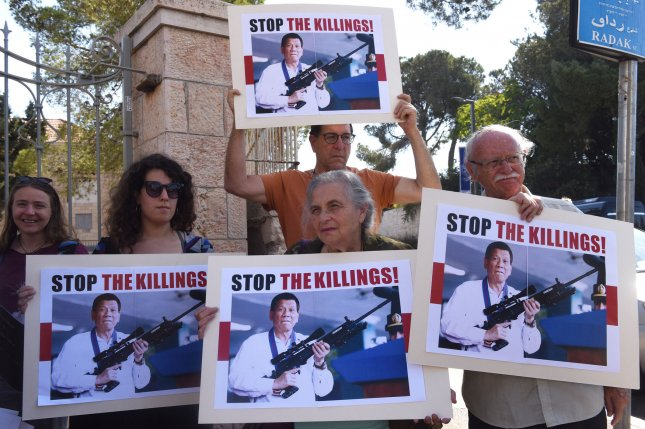 Israeli protesters hold signs during a demonstration outside Israeli President Reuven Rivlin's Jerusalem home on Tuesday, against the visit of Philippine President Rodrigo Duterte. Photo by Debbie Hill/UPI