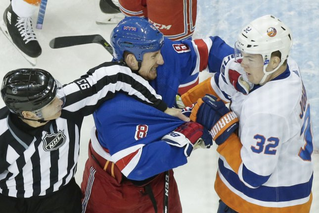 New York Islanders' Ross Johnston and New York Rangers' Cody McLeod have to be separated in the first period on November 21 at Madison Square Garden in New York City. Photo by John Angelillo/UPI